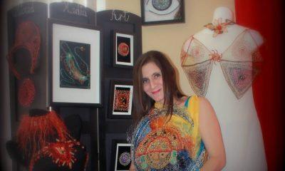 Photo of artist Marita Valdizan and her works