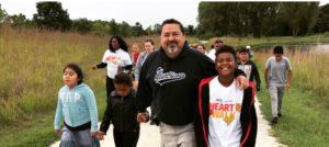 Photo of Mayor Ruben Pineda with children on Move with the Mayor walk