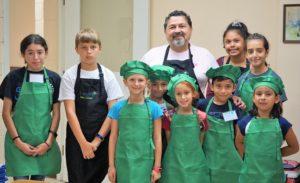Mayor Pineda and cooking class children
