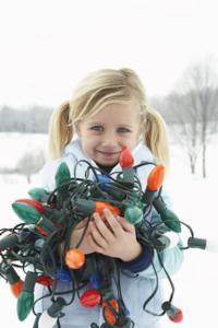 Girl holding Christmas lights