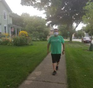 Mayor walking on the sidewalk